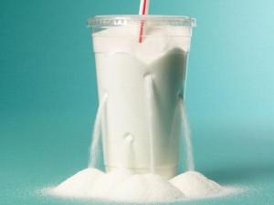 plastic soda cup spilling sugar