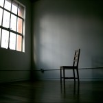 empty chair at window