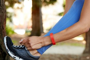 lacing up athletic shoe