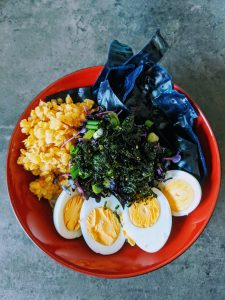 vegetarian meal with greens, grains, and eggs