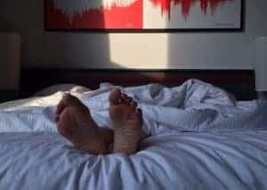 feet sticking out at end of bed