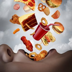 junk food raining into a person's mouth