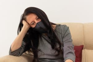 fatigued woman wearing mask